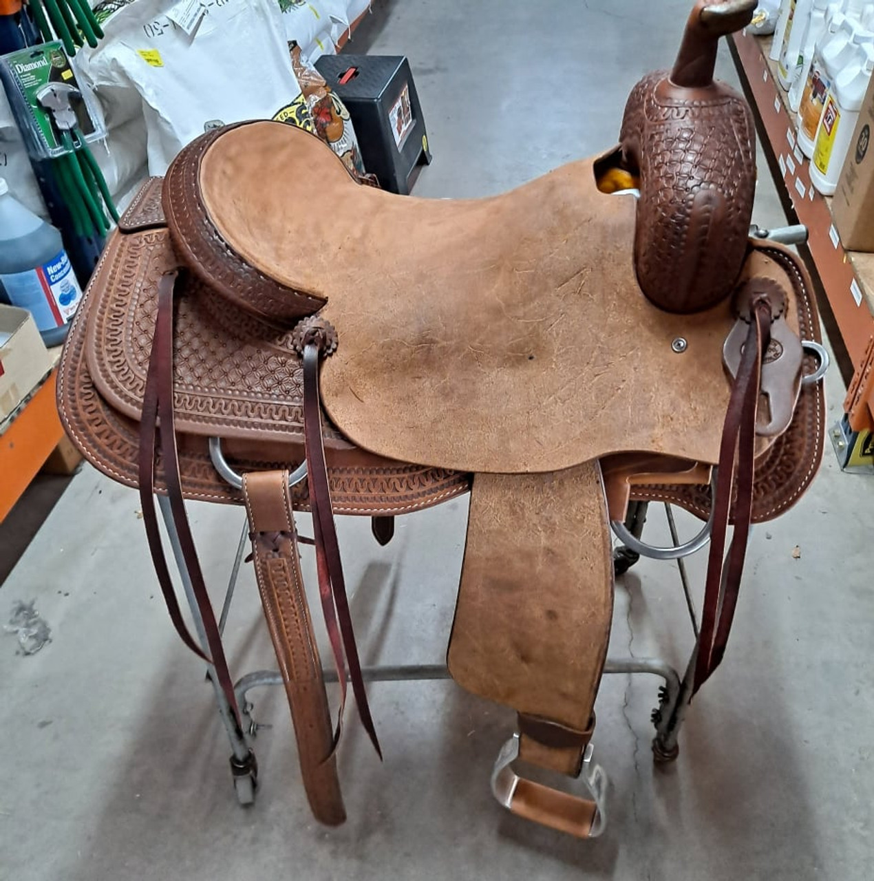 New Ranch Cutter by Fort Worth Saddle Co with 17 inch seat. Well built, hand-tooled ranch cutter. 6 strings, roughout contact points, dark oil finish. Includes latigo and offside, flank billets and flank cinch. Covered by the best warranty in the business. Gullet size is 7 inch, weight is 29lbs, and skirt is 29 inch. Made in USA. Limited lifetime warranty.  S1410