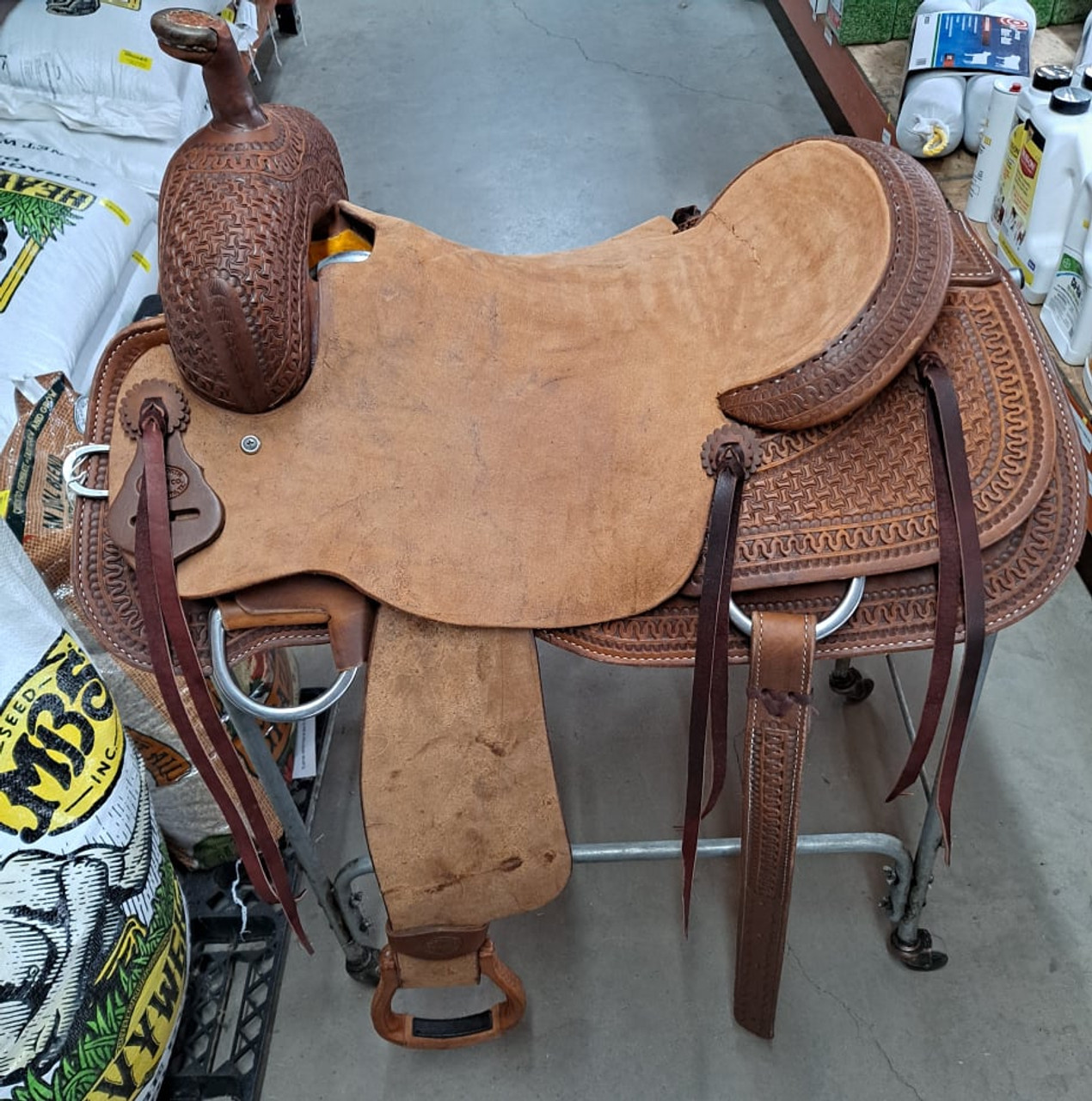 New Ranch Cutter by Fort Worth Saddle Co with 17 inch seat. Well built, hand-tooled ranch cutter. 6 strings, roughout contact points, dark oil finish. Includes latigo and offside, flank billets and flank cinch. Gullet size is 6.5 inch, weight is 27lbs, and skirt is 28.5 inch. Made in USA. Limited lifetime warranty.  S1411