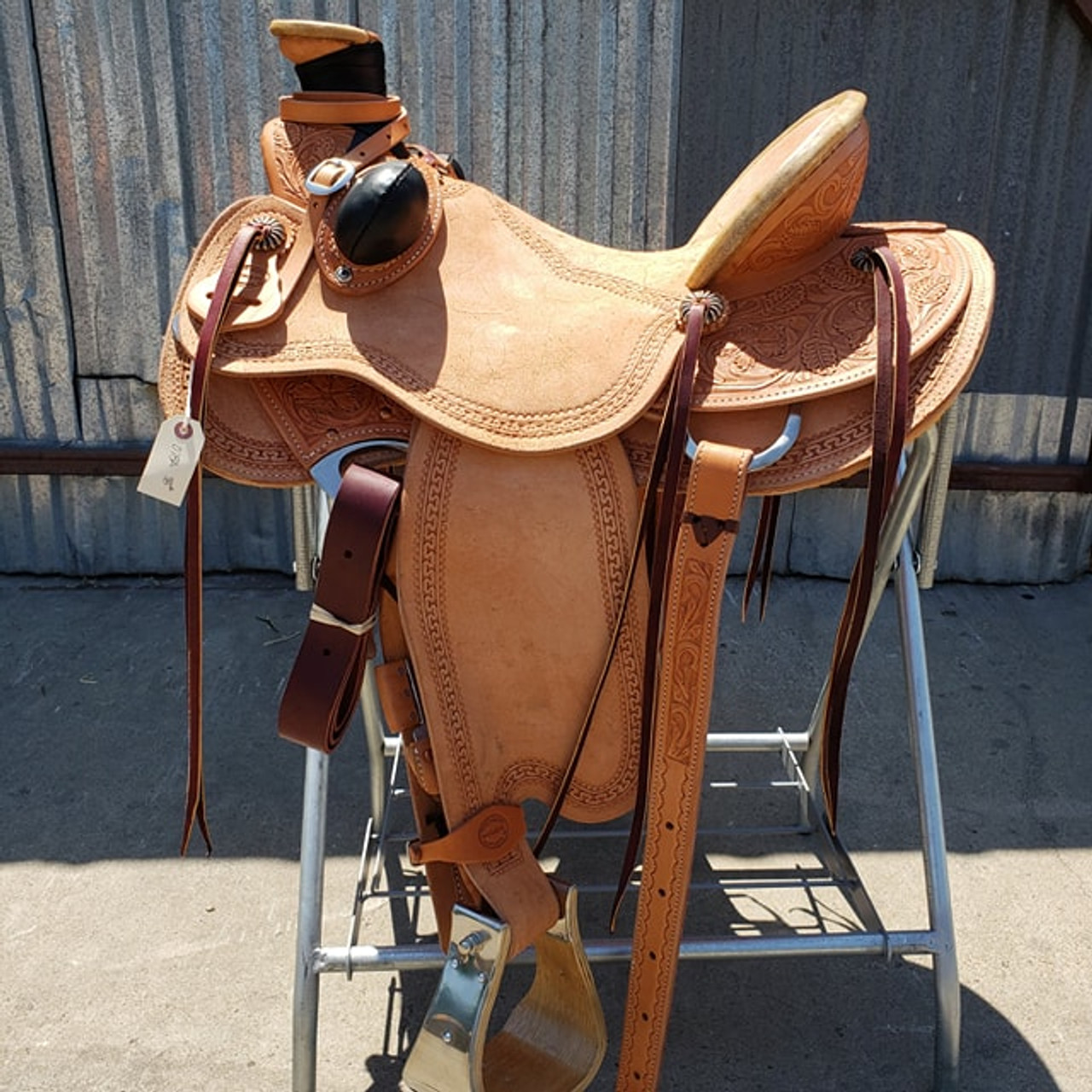 New Wade Saddle by Fort Worth Saddle Co with 17 inch seat. Drop rig, round back, with matching collar and flank cinch. Gullet size is 7.75 inch. Made in USA. Limited lifetime warranty.  S876