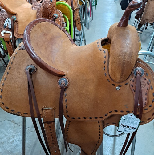 New Jackson Stock Saddle by Fort Worth Saddle Co with 13 inch seat.  All rough out with chocolate buckstitch and pencil roll cantle.  Gullet size is 7.5 inch, weight is 29lbs, and skirt is 24 inch. Made in USA. Limited lifetime warranty.  S976