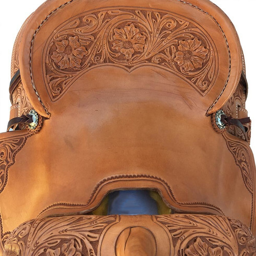 New Stock Saddle in Hermann Oak leather by Fort Worth Saddle Co with 13 inch seat. Light oil slick seat with all floral tooling and floral embellished pencil roll cantle. Gullet size is 7 inch, weight is 27lbs, and skirt is 25 inch. Made in USA. Limited lifetime warranty.  S978
