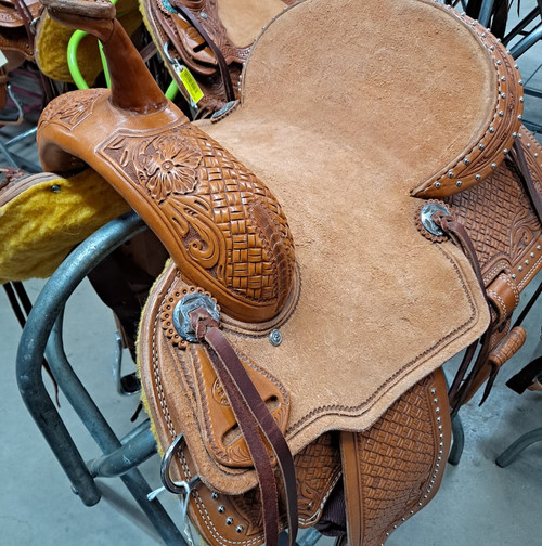 New Stock Saddle in Hermann leather with 14 inch seat.  Light oil with hard rough out seat and silver accent dots. Gullet size is 7 inch, weight is 26lbs, and skirt is 25 inch. Made in USA. Limited lifetime warranty.  S980