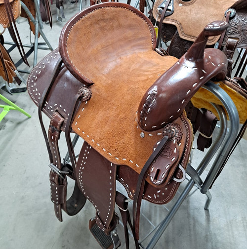 New Stock Saddle in Hermann Oak leather by Fort Worth Saddle Co with 14 inch seat. Chestnut half breed with white buckstitch and silver dots. Gullet size is 7 inch, weight is 30lbs, and skirt is 24 inch. Made in USA. Limited lifetime warranty.  S983