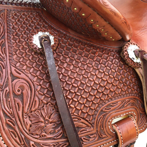 New Stock Saddle in Hermann Oak leather by Fort Worth Saddle Co with 14 inch seat. Slick jockeys and seat, fully tooled fenders, pommel and skirt. Pencil roll. Gullet size is 8 inch, weight is 27lbs, and skirt is 25 inch. Made in USA. Limited lifetime warranty.  S987