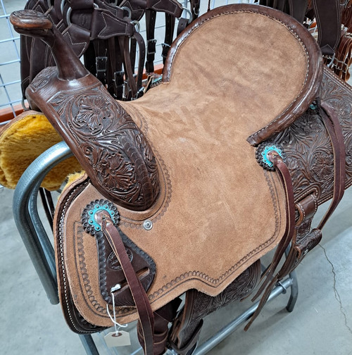 New Stock Saddle in Hermann Oak leather by Fort Worth Saddle Co with 14 inch seat. Floral hand-tooling on skirt, fenders, flank billets and pommel. Pencil roll roughout seat. Gullet size is 8 inch, weight is 27lbs, and skirt is 26 inch. Made in USA. Limited lifetime warranty.  S991