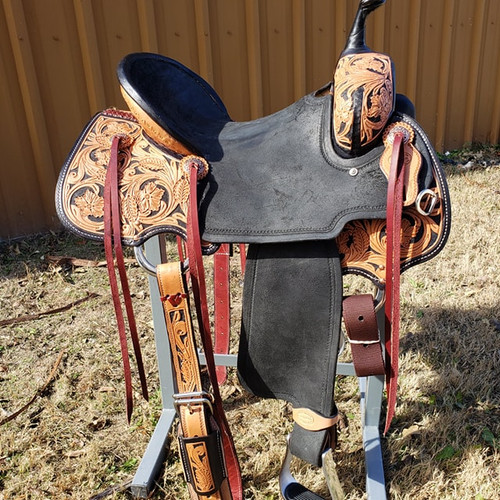 New Cheyenne Stock Saddle by Fort Worth Saddle Co with 15 inch seat.  Black and tan motif. Dark black antiqued tooling. Black roughout pencil roll seat and fenders. Gullet size is 7.5 inch, weight is 30lbs, and skirt is 26.5 inch. Made in USA. Limited lifetime warranty.  S1017
