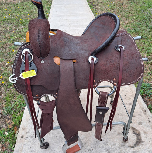 New Cheyenne j2 Stock Saddle by Fort Worth Saddle Co with 13.5 inch seat. Premium leather in chocolate roughout.Skirt rigged fenders for extra stirrup freedom. Secure pencil roll seat. Gullet size is 7.5 inch, weight is 30lbs, and skirt is 25 inch. Made in USA. Limited lifetime warranty.  S1249