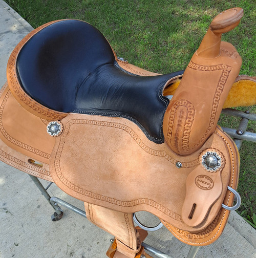 New Trail or Pleasure Saddle by Fort Worth Saddle Co with 16 inch seat. Light oil. Black padded leather seat. Cheyenne roll. Gullet size is 7.5 inch, weight is 29lbs, and skirt is 27 inch. Made in USA. Limited lifetime warranty.  S1297