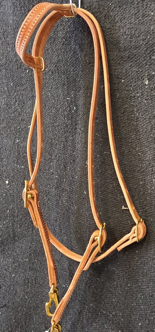 Berlin single ear headstall with brass plated snaps and throat latch. Hermann oak leather.