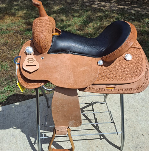 New Trail or Pleasure Saddle by Fort Worth Saddle Co with 16 inch seat. Double padded black leather seat. Border tooled. Gullet size is 7.5 inch, weight is 22lbs, and skirt is 27 inch. Made in USA. Limited lifetime warranty.  S1372