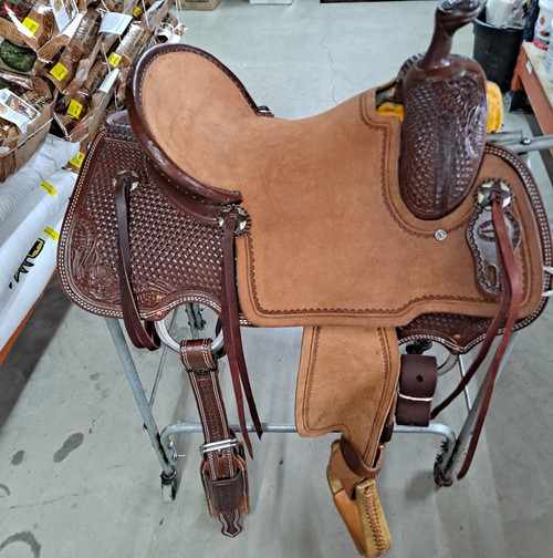 """New All Around Saddle by Fort Worth Saddle Co with 15.5 inch seat. Built on our new proprietary Jplus """"hog-bars"""" roping tree, our new all-around saddle is lightweight, but can be roped from. Limited lifetime warranty on tree. Constructed of Hermann Oak leather. Hand tooled. Secure pencil roll seat. Drop-rigged for added stability. Gullet size is 7.5 inch, weight is 28lbs, and skirt is 27 inch. Made in USA. Limited lifetime warranty.  S1392"""