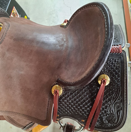 """New All Around Saddle by Fort Worth Saddle Co with 15.5 inch seat. Built on our new proprietary Jplus """"hog-bars"""" roping tree, our new all-around saddle is lightweight, but can be roped from. Limited lifetime warranty on tree. Constructed of Hermann Oak leather. Hand tooled. Secure pencil roll seat. Drop-rigged for added stability. Gullet size is 8 inch, weight is 28lbs, and skirt is 27.5 inch. Made in USA. Limited lifetime warranty.  S1395"""