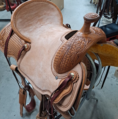 """New All Around Saddle by Fort Worth Saddle Co with 15 inch seat. Built on our new proprietary Jplus """"hog-bars"""" roping tree, our new all-around saddle is lightweight, but can be roped from. Limited lifetime warranty on tree. Constructed of Hermann Oak leather. Hand tooled. Secure pencil roll seat. Drop-rigged for added stability. Gullet size is 7.25 inch, weight is 32lbs, and skirt is 26.5 inch. Made in USA. Limited lifetime warranty.  S1397"""