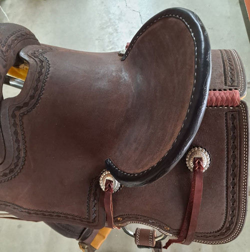 """New All Around Saddle by Fort Worth Saddle Co with 13.5 inch seat. Built on our new proprietary Jplus """"hog-bars"""" roping tree, our new all-around saddle is lightweight, but can be roped from. Limited lifetime warranty on tree. Constructed of Hermann Oak leather. Hand tooled. Secure pencil roll seat. Drop-rigged for added stability. Gullet size is 8.25 inch, weight is 35lbs, and skirt is 26 inch. Made in USA. Limited lifetime warranty.  S1399"""