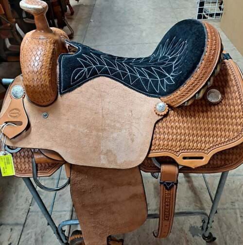 """Fort Worth Saddle Co Calf Roping Saddle with 16"""" seat and 7"""" gullet. Rawhide Cheyenne roll wrapped with metal. Tooled medium oil skirts, pommel, and cantle.  S053"""