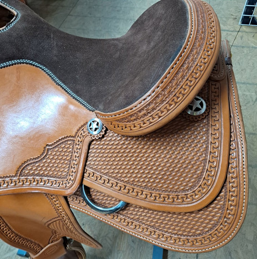 """Reining saddle in light oil hand-tooled Hermann Oak leather. Padded leather 14.5"""" seat, Real wool saddle fleece. 6.5"""" gullet, 28"""" skirt. Latigo and offside included.  Limited lifetime warranty on US made rawhide over hardwood tree. Made in Texas by Ft Worth Saddle Co."""