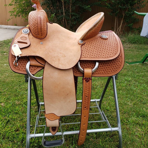 New Mounted Shooter Saddle by Fort Worth Saddle Co with 15.5 inch seat.  Hard seat. Half-breed construction with roughout seat. Gullet size is 7 inch. Made in USA. Limited lifetime warranty.  S699