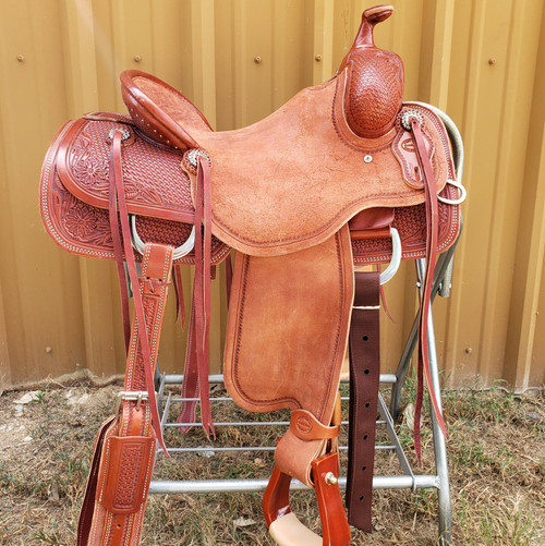 New Mounted Shooter Saddle by Fort Worth Saddle Co with 15 inch seat.  Antiqued caramel. Pencil roll. 6 string.  Gullet size is 7.5 inch, weight is 33lbs, and skirt is 25 inch. Made in USA. Limited lifetime warranty.  S935