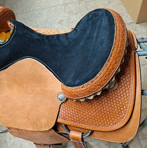 """Fort Worth Saddle Co Roping Saddle. 15"""" seat and 7"""" gullet. Hand-tooled skirt, cantle and pommel. Metal wrapped rawhide Cheyenne roll cantle.   S116"""