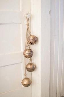 Decorative String Of Brass Finish Bells