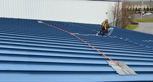 SSRA3 Anchor plate attached with SSRA1 Anchors to a standing seam roof system for horizontal lifeline attachment.