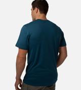 back view of model bermuda blue tee