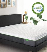 bare resort mattress in a bed frame with the certipur-us stamp in the corner