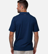 back view of model wearing navy performance polo