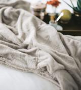 ruffled close up on coconut milk plush blanket