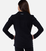 back view of girl wearing cariloha fit jacket showing the cariloha branding on the back of the neck