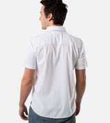 back view of model wearing white navy geometric print button up shirt
