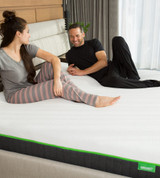 couple laying on a bare cariloha classic mattress