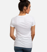 back view of model wearing white crew tee