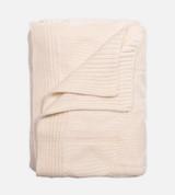 above view of Diamond Coconut Milk knit throw