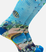 close-up on men's printed socks featuring and ocean blue scene