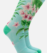 close-up on women's bamboo printed trouser socks featuring our hibiscus floral aqua design
