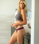 side view of model wearing merlot thong