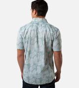 back view of model wearing ocean green foliage print button up shirt