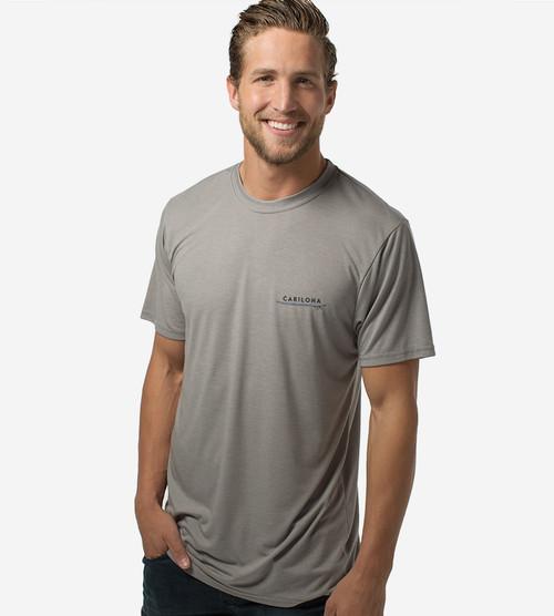 front view of model wearing da vinci surfer comfort crew tee left chest design