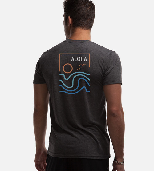 back view of model wearing charcoal tee with  water, waves, sun back design