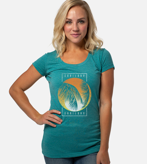 front view of model wearing teal scoop with frond silhouette design