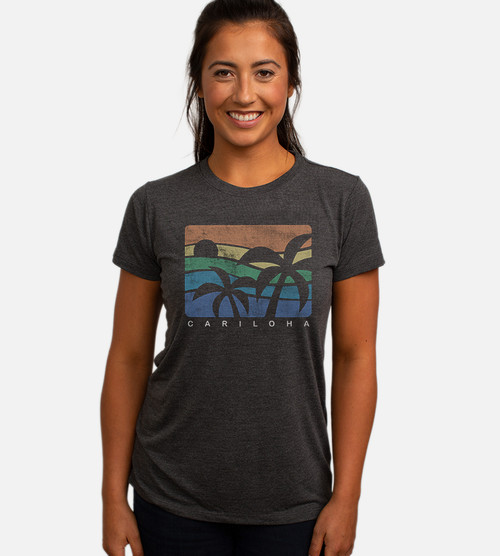 front view of model wearing charcoal crew tee with fun palms design
