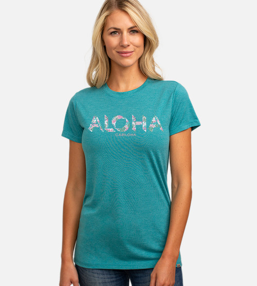 front view of model wearing teal crew tee with aloha shadow design
