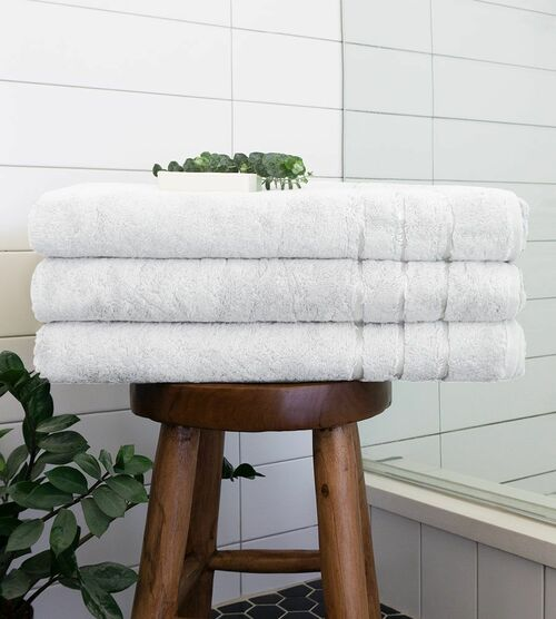 white bamboo bath sheet on a stool