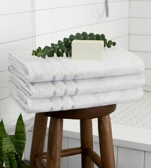 stack of bamboo towels on the wooden stool