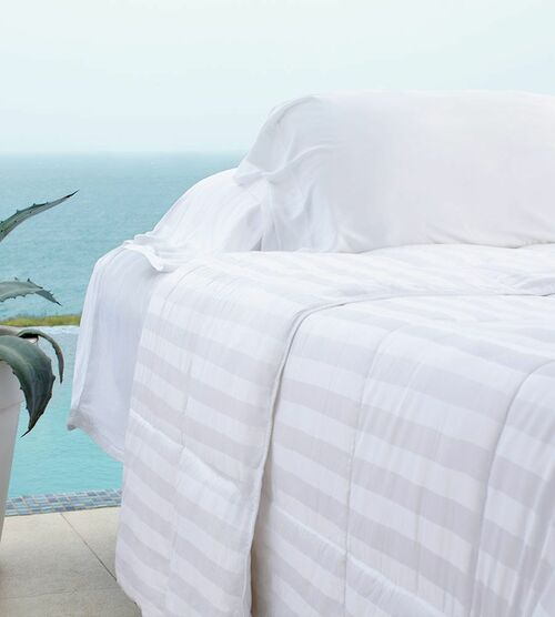 bamboo duvet comforter close in front of the ocean