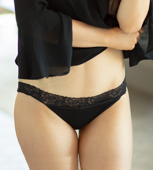 front view close-up of model wearing black bikini undies