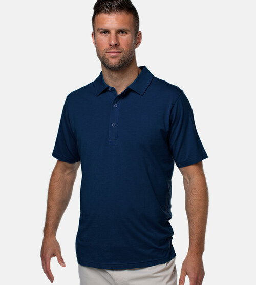 front view of model wearing navy performance polo