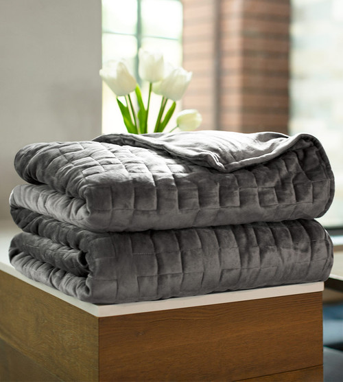 folded weighted blankets on a table