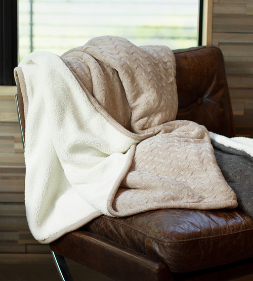 ruffled folded stone knit sherpa blanket on a chair